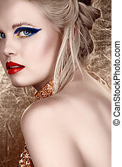 blond woman with dark eyeshadow - beautiful blond with hair...
