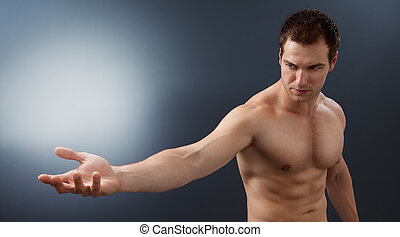 Light and power concept - creative muscular man holding...