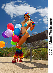 Sexy bikini girl with colorful balloons