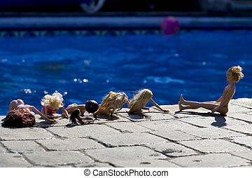 Dolls By The Pool - A group of poolside naked female dolls...