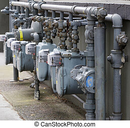Gas meter row - Row of Six gray gas meters manifolded...