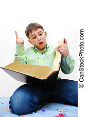 Eduction - Boy reading a giant book