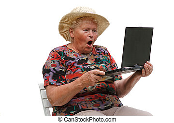Senior woman with a computer on white background