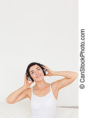 Portrait of a charming woman listening to music