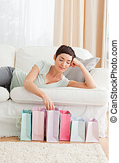 Young woman looking into shopping bags