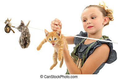 Image Manipulation of Girl Hanging Kittens on Clothes Line -...