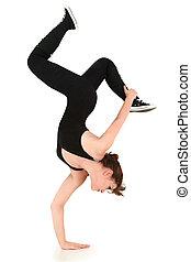 flexível, forte, adolescente, fazendo, handstand,...