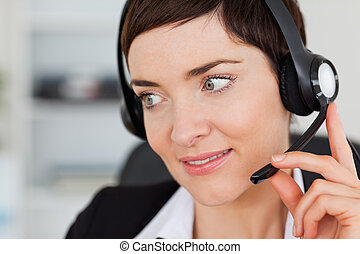 Close up of a professional secretary calling with a headset
