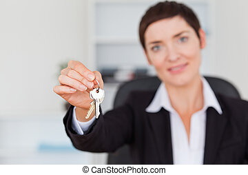 Businesswoman showing keys