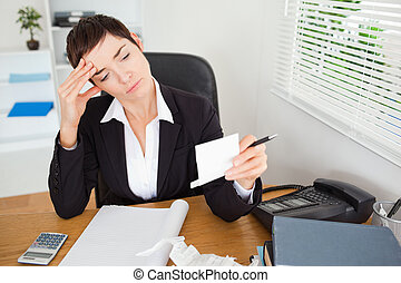 Unhappy accountant checking receipts in her office