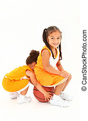 Preschool Basketball Team-mates over white - Adorable girl...