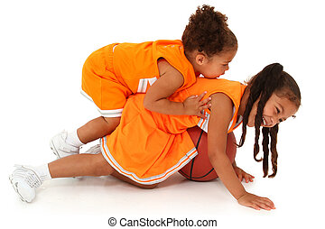 Two Adorable African-Hispanic Girls Playing Basketball - Two...