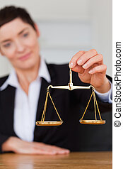 Serious woman holding the justice scale