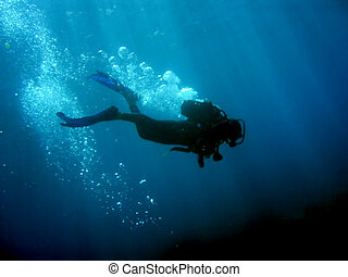 Scuba Diver With Bubbles - Diver with bubbles and sunrays...