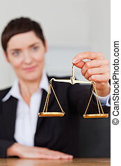 Portrait of a businesswoman holding the justice scale