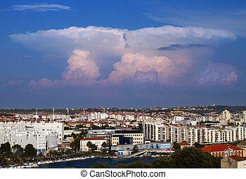 Towering cumulus over city.