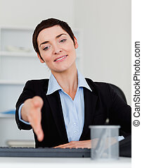 Portrait of a charming business woman giving her hand