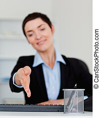 Portrait of a business woman giving her hand