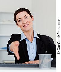 Portrait of a smiling business woman giving her hand while...