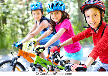 Young cyclist - Three little children riding their bikes