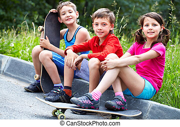 Skating children - Three little children with skateboards...
