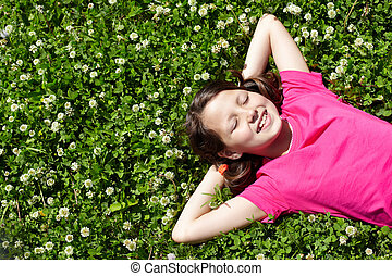 Relaxing child - High angle view of a little girl resting on...
