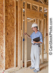 Building Inspector - Building inspector checking building...