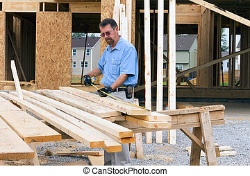 Carpenter inspecting wood before selecting the next support...