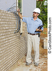 Building Inspector - Building inspector checking electrical...