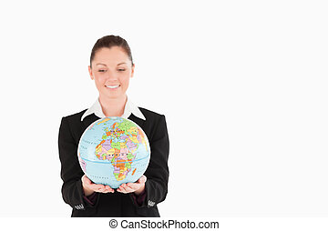 Attractive woman in suit holding a globe
