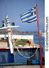 Old Greek flag on a fishing boat