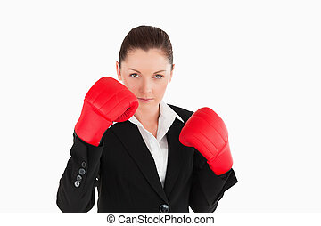 Beautiful woman wearing some boxing gloves while standing...