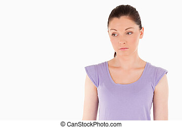 Unhappy woman posing while standing