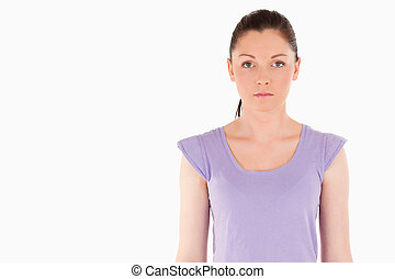 Sad woman posing while standing