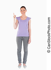 Good looking woman pointing at a copy space