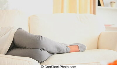 Woman posing on a sofa