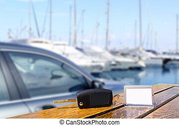 Car rental keys on wood table in Mediterranean vacation -...