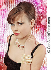 pearl adornments - Young beautiful woman with the pearl...