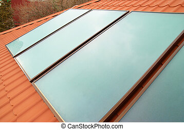 Solar water heating system (geliosystem) on the red house...