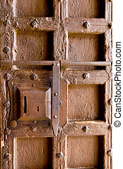 aged medieval wooden door lock keyhole