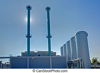 Community energy plant with smokestacks and tanks