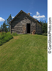Log cabin in the woods - Photo of an old log cabin in the...