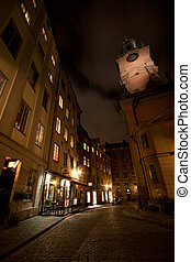 Back alley - A back alley in Stockholm with a tall church in...