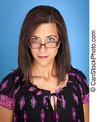 Pretty woman - Attractive woman with brown hair peering over...