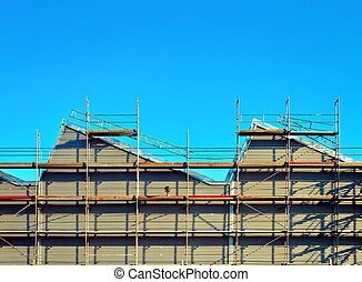 Scaffolding on a factory wall - Factory with aluminum...