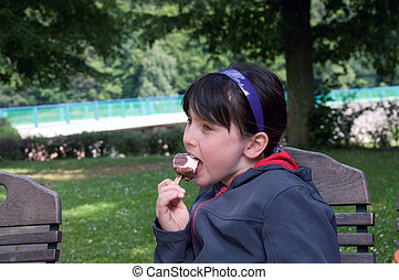 Girl eating ice cream. - Freckled girl eating ice cream.