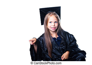 Portrait of cute gesticulating girl in black academic cap with liripipe and gown on isolated white