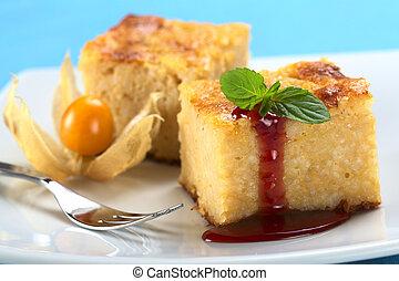 Baked rice pudding dessert with strawberry sauce and a mint...