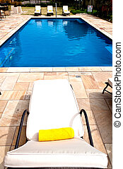 Swimming Pool - Sunbed on a swimming pool in a hotel