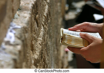 Prayer holds Torah during prayer at Western Wall - Prayers...